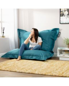 Lady sitting in teal bazaar bag bean bag in living room