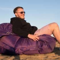 Boy on a bean bag with shades on